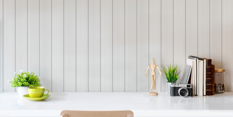 Wall Mural - Modern stylish workplace with office supplies and copy space on white table and grey plank wall