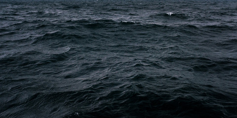 Dark and blue sea water surface
