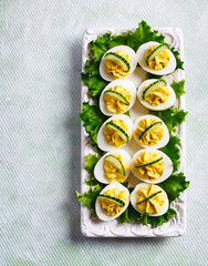 Deviled Eggs with Cucumber as an Appetizer, top view, copy space