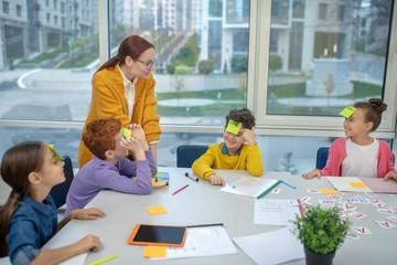 Teacher moderating an interesting game at school
