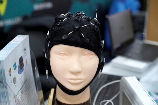 An electrode cap, part of a stress EEG assessment system, is displayed in the Hipposcreen Neurotech booth at CES Unveiled during the 2020 CES in Las Vegas
