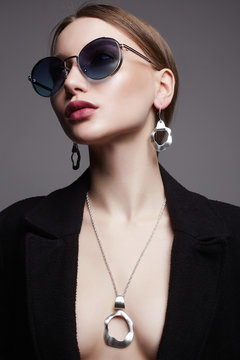 Beautiful sexy woman in sunglasses and jewelry