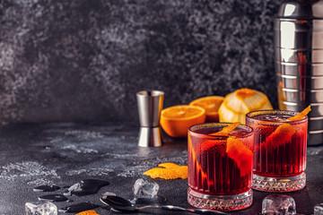 Negroni cocktail with orange peel and ice.