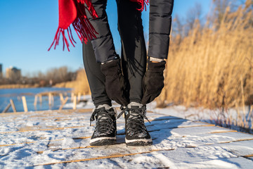 Ready for winter woman tying boot laces hiking boots for snow and ice anti slippery soles for...