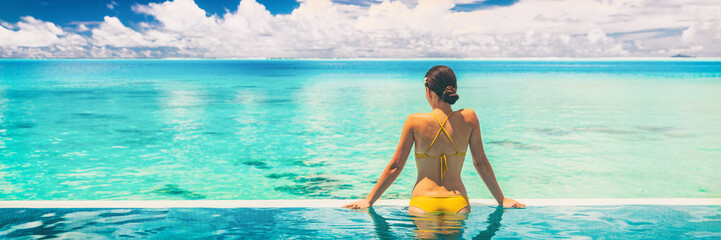 Foto auf AluDibond Individuell Hotel swimming pool luxury travel vacation summer holiday panoramic banner background with woman in bikini enjoyin sun tan swim lifestyle.