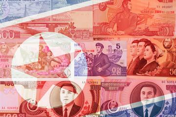 North Korea Won banknotes on a national flag background. High resolution vintage photo of North Korean bill, DPRK money close up macro.