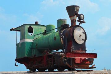Unused old rusty antique green steam train locomotive