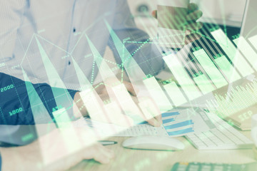 Photo sur Aluminium Pharmacie Multi exposure of chart with man typing on computer in office on background. Concept of hard work.