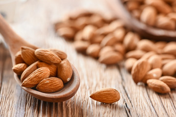 Almond nuts on wooden table top view. Fresh almonds copy space.