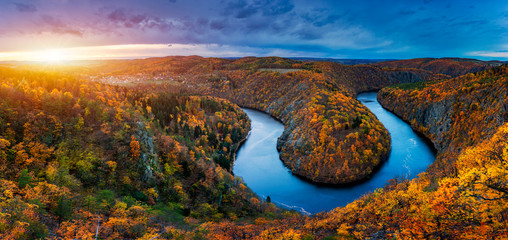 Beautiful Vyhlidka Maj, Lookout Maj, near Teletin, Czech Republic. Meander of the river Vltava surrounded by colorful autumn forest viewed from above. Tourist attraction in Czech landscape. Czechia.