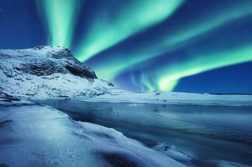 Photo sur Aluminium Bleu jean Aurora Borealis, Lofoten islands, Norway. Winter landscape in the night time during polar lights. Nothen light, mountain and frozen water. Norway - image