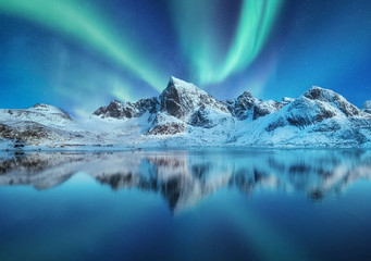 Door stickers Blue jeans Aurora Borealis, Lofoten islands, Norway. Northen lights, mountains and reflection on the water. Winter landscape during polar lights. Norway travel - image