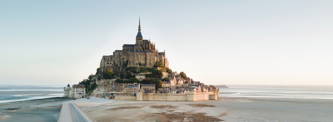 Le Mont Saint Michel tidal island in beautiful twilight at dusk, Normandy, France shot from aerial perspective Fotomurales