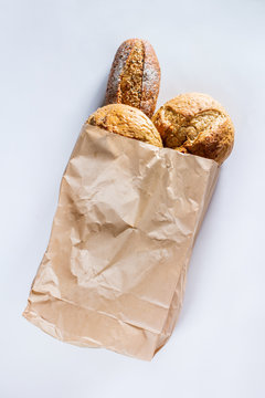 Whole grain bread with seeds in ecology paper bag
