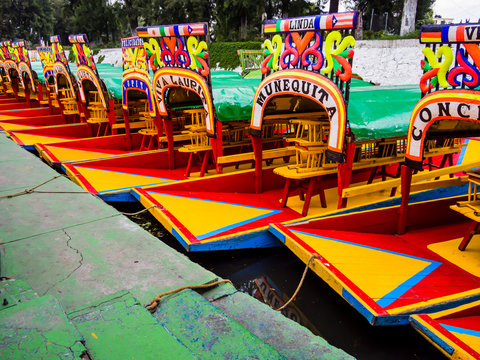 Row of traditional, colorful boats in Xochimilco, Mexico City