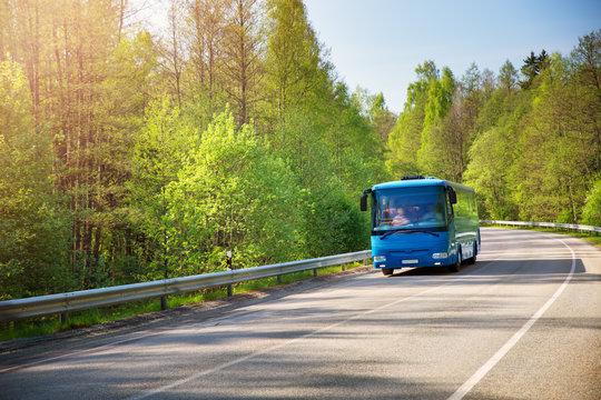 Bus on asphalt road in beautiful spring day