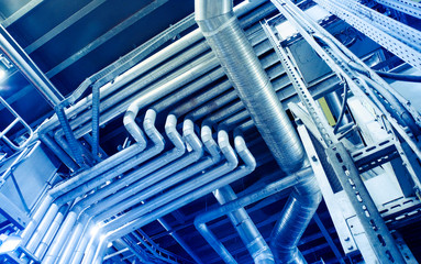 Equipment, cables and piping as found inside of a modern industrial power plant. Industrial zone,...