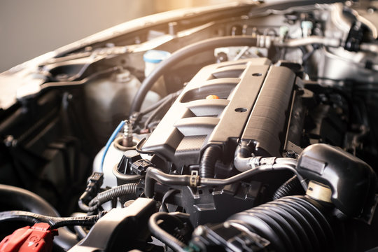 details of modern car engine with sunlight effect, shallow depth of field, internal combustion engine vehicle