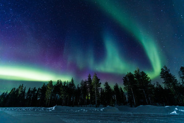 Foto op Aluminium Noorderlicht Northern lights Aurora Borealis activity over the road in Finland, Lapland