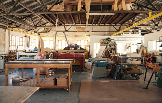 Interior of a large woodworking studio full of machinery