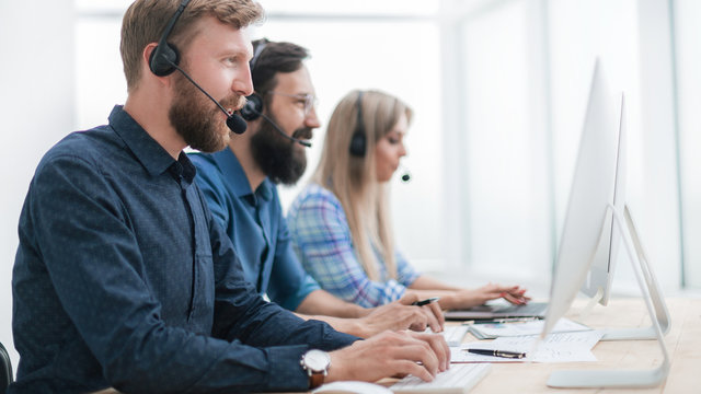 group of business center consultants working in the call center
