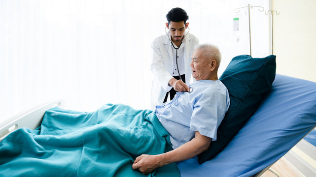 Senior Asian patients lying hospital bed, receiving medical treatment from specialist doctor. Physical examination Such as respiratory system, heartbeat, diabetes and pressure. Concept life insurance