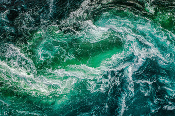Abstract background. Waves of water of the river and the sea meet each other during high tide and low tide. Whirlpools of the maelstrom of Saltstraumen, Nordland, Norway Fotomurales