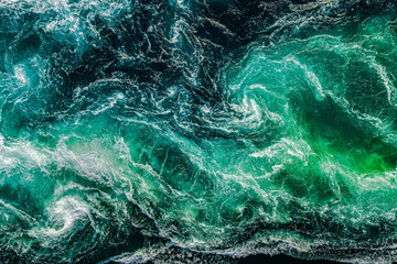 Abstract background. Waves of water of the river and the sea meet each other during high tide and...