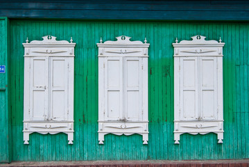 Windows with carved frames on wooden house in Tyumen city ,Siberia ,Russia