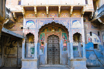 Facade of an old mansion with a painting in the city of Sikar, Rajasthan, India