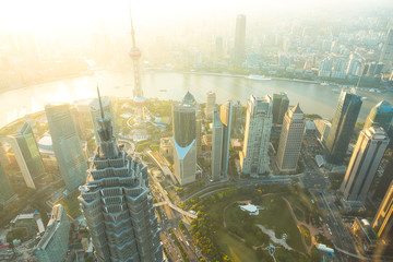 Foto auf AluDibond Shanghai Shanghai Aerial View at Sunset with Urban Skyscrapers over the River