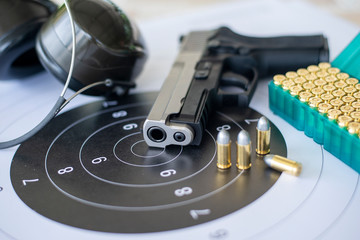 Guns with ammunition on paper target shooting   practice