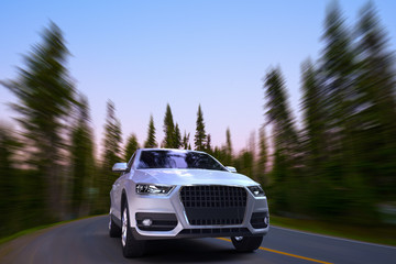 3D rendering of an SUV on motion in a road at a forest.