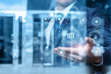 Businessman showing iot structure .