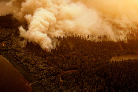 Aerial view forest fire on the slopes of hills and mountains