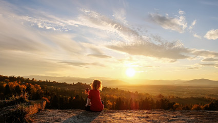Wall Murals Beige The boy enjoys the sunset in the mountains