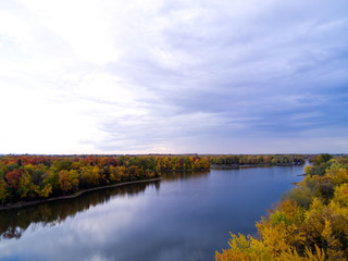 Aerial landscape with river and cloudy sky in Autumn