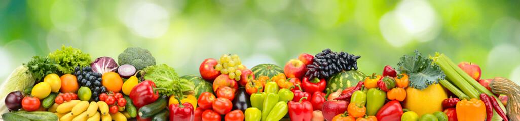 Foto op Plexiglas Keuken Panorama multicolored fresh fruits and vegetables on green background.