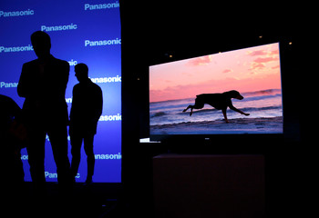 A video of a dog plays on a Panasonic HZ2000 4K OLED television at a Panasonic news conference during the 2020 CES in Las Vegas