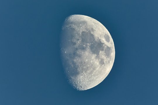 The Moon detailed shot in blue daylight sky, taken at 1600mm focal length, waxing gibbous phase
