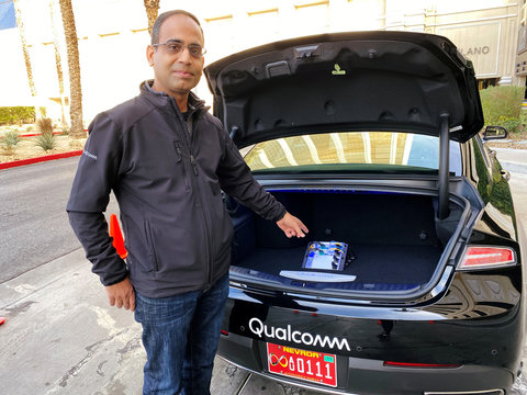 Dheeraj Ahuja, Senior Director Of Engineering at Qualcomm, shows the new Snapdragon Ride autonomous driving computing system in the trunk of a demo car at the Consumer Electronics Show in Las Vegas
