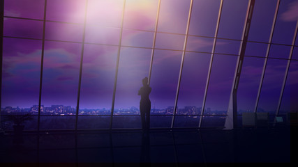 In a dark office, business woman is looking at the night city.