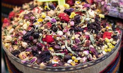 Mixed herbal tea being sold in front of store.