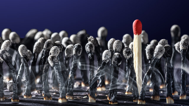 Group Of Burnt Matchsticks With One Survivor - Employee Hiring / Leadership Concept
