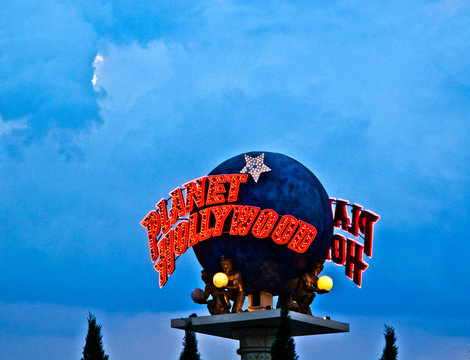 Planet Hollywood globe  on the Las Vegas Strip in the late afternoon in neon light