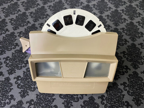 WOODBRIDGE, NJ / UNITED STATES - January 6, 2020: A vintage tan colored View-Master from the 1960s  with a reel inserted