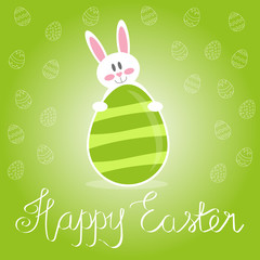 Green Easter card with white bunny holding an easter egg. Calligraphy Happy Easter card