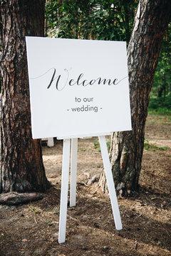 Elegant easel welcoming guests to wedding