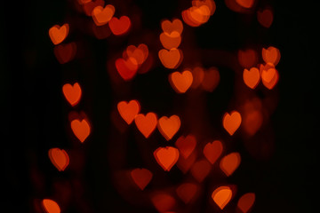 Valentines background. Abstract heart bokeh background. Defocused blurred heart shaped lights. St. Valentines Day background