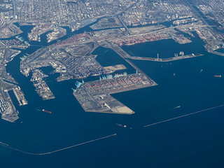 Shipping containers line the dock at the port in Los Angeles